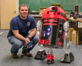 Geran Call with the 3d printed R2D2 robot. Geran runs the Robotics 3d Printing Lab at Idaho State University College of Technology where this R2D2 was built.