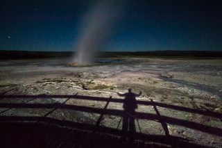 Shadow selfy with a geyer at night in Yellowstone National Park
