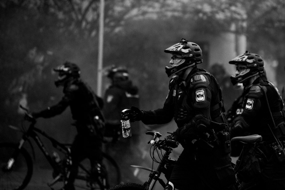 bike cop with pepper spray
