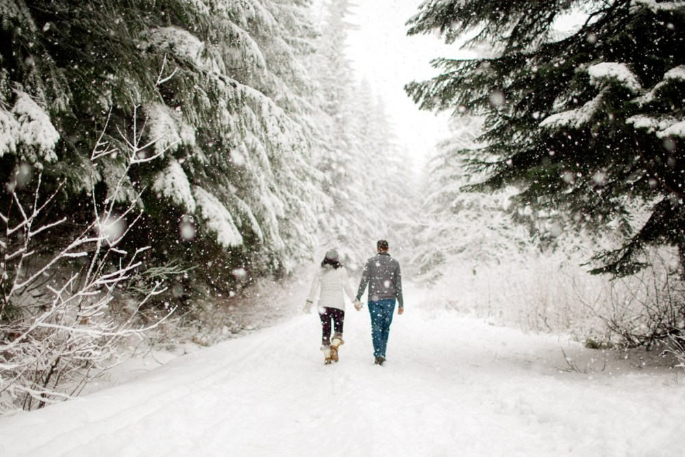couple walking away in the snow