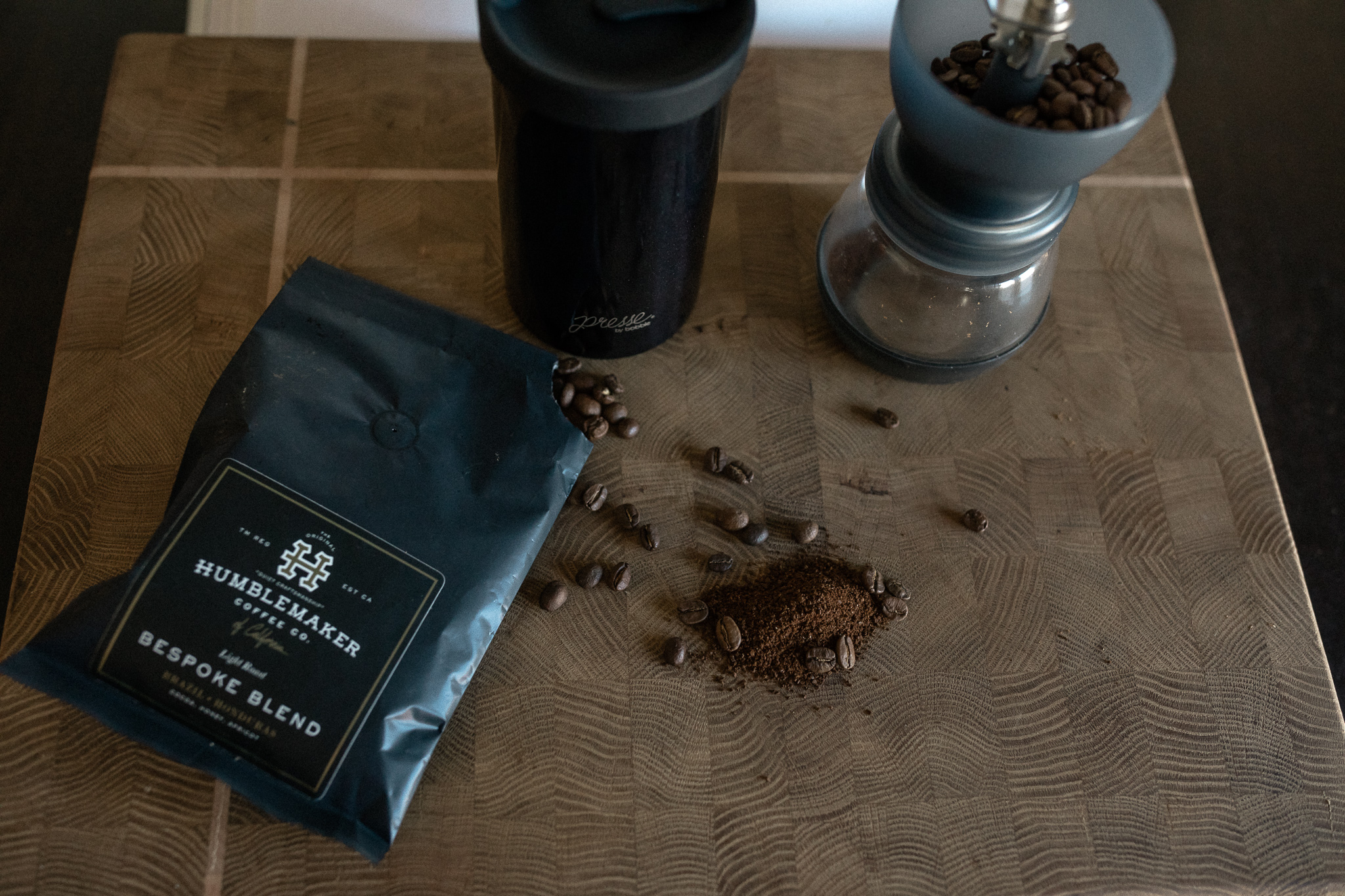 top view of beans and grinder with french press