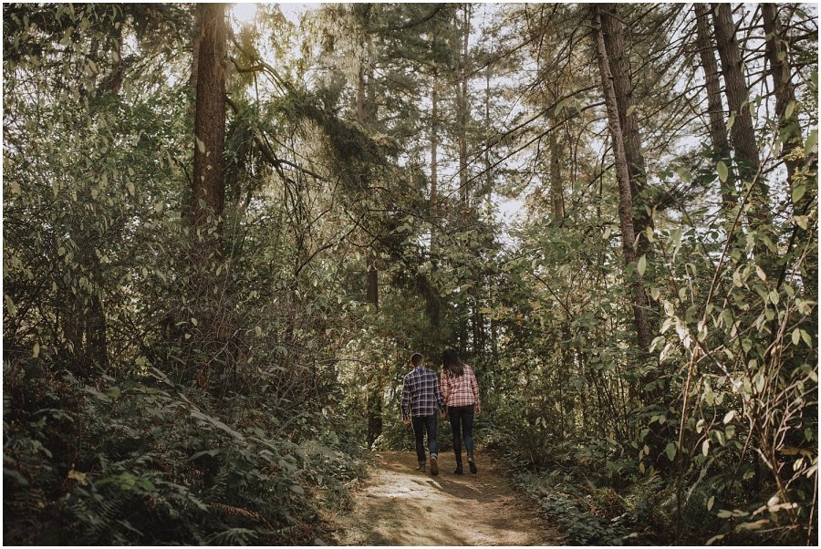 Couple walking through trees Seattle Wedding and Elopement Photographer Kyle Szeto