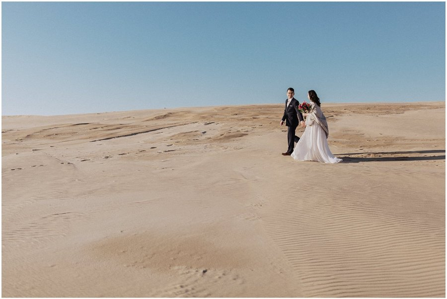 desert inspired elopement couple walking