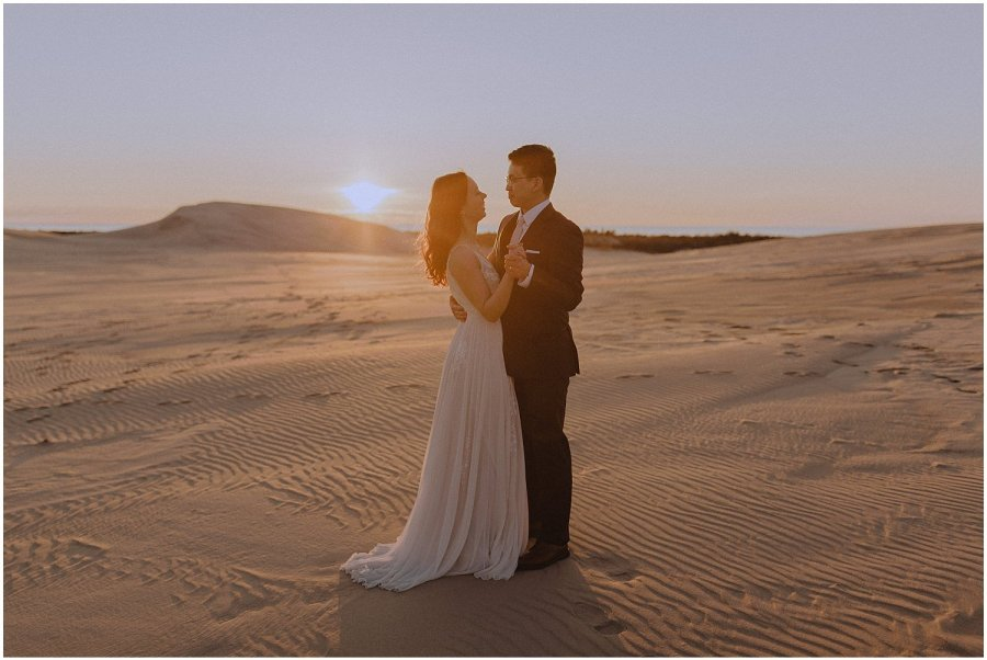 desert inspired elopement couple dancing as the sun sets