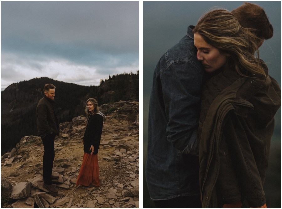 couple cuddling on a mountain