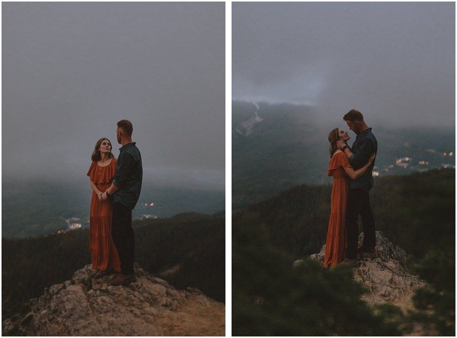 a couple standing on top of a mountain