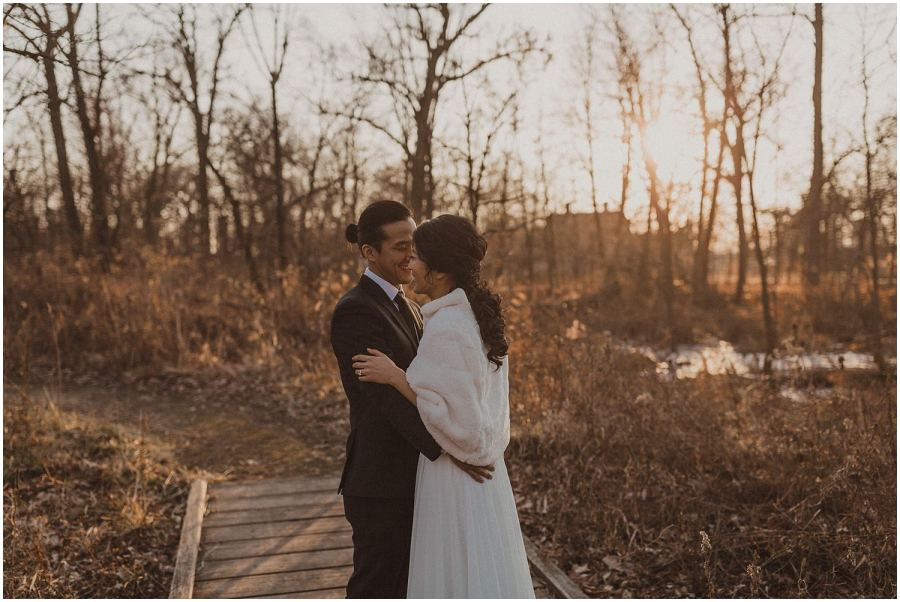 bride and groom in the woods as the sun sets behind them Chicago wedding photographer kyle szeto