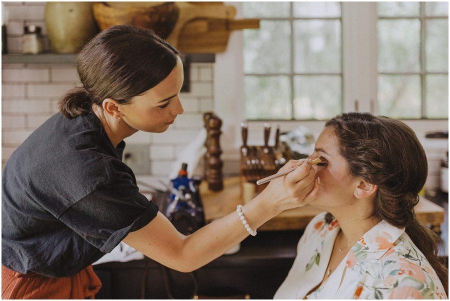 bride getting her makeup done wisconsin wedding elopement photographer kyle szeto