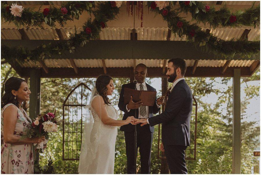 couple exchanging rings wisconsin wedding elopement photographer kyle szeto
