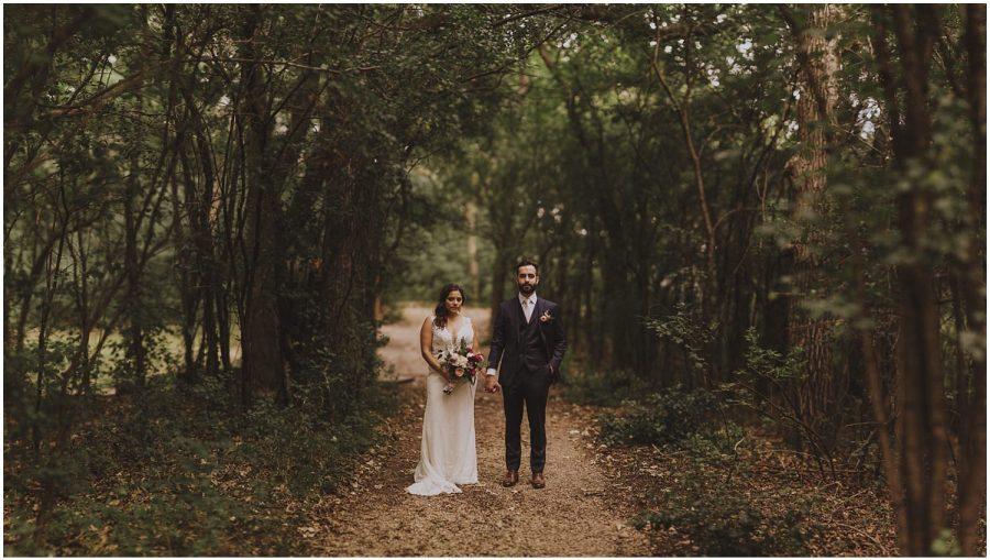 couple standing in the woods wisconsin wedding elopement photographer kyle szeto