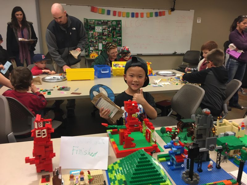 Lego Workshop Introduces Over 250 Kids to Engineering During CR s     Kid building with Lego