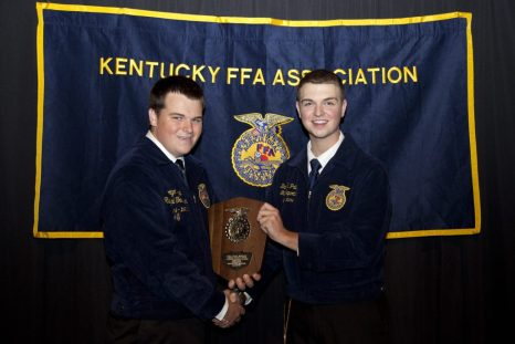 Kentucky FFA Treasurer Daniel Patton (right) presents George Bittel of the Owensboro Catholic FFA Chapter with the Kentucky FFA State Swine Production Proficiency award. Bittel's proficiency will represent the Kentucky FFA Association in October at the National FFA Convention in Louisville.