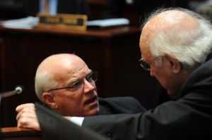 Senator Dennis Parrett (left), D-Elizabethtown, conferred with Senate Democratic Caucus Whip Julian M. Carroll, D-Frankfort, during early January on the floor of the Kentucky State Senate.
