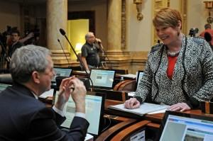 Senator Dorsey Ridley (left), D-Henderson, confers with Senator Denise Harper Angel, D-Louisville, during a brief recess on the floor of the Senate.