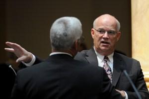 Sen. Dennis Parrett, D-Elizabethtown (right), speaks with Sen. Paul Hornback, R-Shelbyville, before the start of the day's legislative session in the Kentucky Senate.