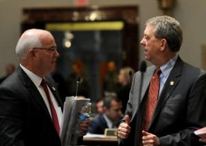 Senator Dorsey Ridley, D-Henderson (right), speaks with Senator Dennis Parrett, D-Elizabethtown, during a recess period in the Kentucky Senate.
