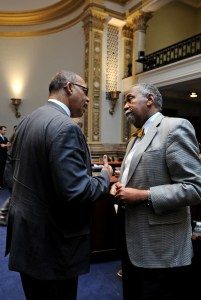 Senator Reginald Thomas (left), D-Lexington, and Senate Democratic Caucus Chair Gerald A. Neal, D-Louisville, step away from their desk to talk about issues facing the 2016 Kentucky General Assembly. Today marks the 6th legislative day of the 60-day session.