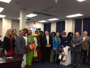 Senator Perry B. Clark, D-Louisville, (back right) was joined by some hair braiders on March 23 at the House Licensing and Occupations Committee meeting to support Senate Bill 269, which would remove barriers for practicing hair braiding. Rep. Reginald Meeks, D-Louisville (third from left) carried the bill in committee. SB 269 now moves to the House of Representatives for further consideration.