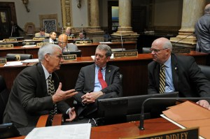 Senator Dorsey Ridley (center), D-Henderson, confers with Senator Dennis Parrett (right), D-Elizabethtown, and Senator Paul Hornback, R-Shelbyville, during a brief recess on the Senate floor.