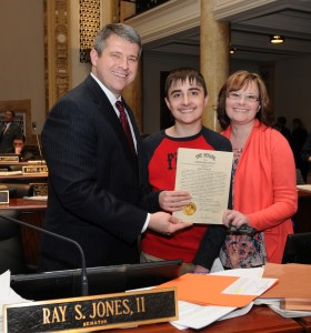 Senate Democratic Floor Leader Ray S. Jones II (left), D-Pikeville, on Feb. 23 honored Blake Edmonds on the floor of the Kentucky State Senate for his service on behalf of Kentuckians living with epilepsy. Blake has been selected by the Epilepsy Foundation of Kentuckiana to join 40 other youth from across the United States as participants in the national Epilepsy Foundation's 2016 Teen Speak Up! Program in Washington, D.C. in April 2016. Blake was joined in Frankfort today by his mother, Diane Edmonds.