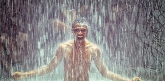 man under waterfall, waterfall, strong