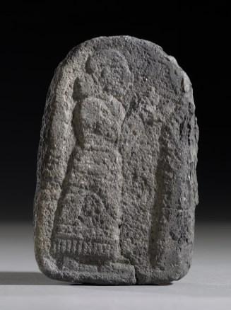 Stèle sculptée de basalte avec la description d'une prière, de Tell Halaf (Syrie), 10e-9e siècle avant J.-C. Portant encore les traces d'un bombardement de la Seconde Guerre mondiale à Berlin, en Allemagne. © Musée d'État de Berlin.