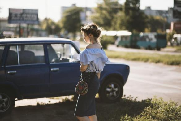 Woman Walking Near Sedan
