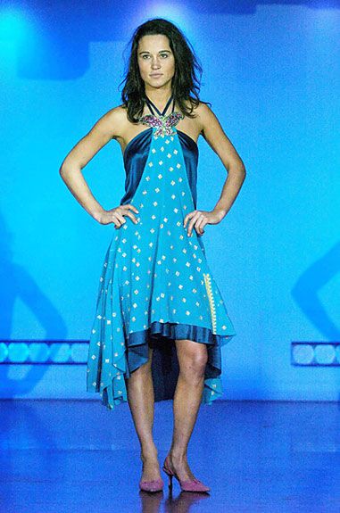 Pippa Middleton wearing a blue halter dress designed by a fellow University of Edinburgh student, Rowan McIntosh, at a fundraiser in 2004. (Alan Peebles/Scope Features)