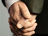 File photo shows a gay couple holding hands (Reuters)