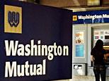 A customer using an ATM machine at a Washington Mutual bank in La Canada, California (AFP)