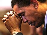 Barack Obama prays (AP)