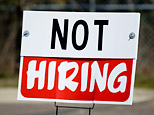 A sign outside of a workplace says 'Not hiring' (iStockPhoto)