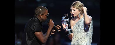 Kanye West confronts Taylor Swift at the 2009 MTV Video Music Awards (Kevin Mazur/WireImage)