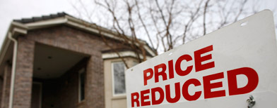 A price reduction sale tops the sale sign of an existing home on the market in the south Denver suburb of Greenwood Village, Colo. (AP file photo)