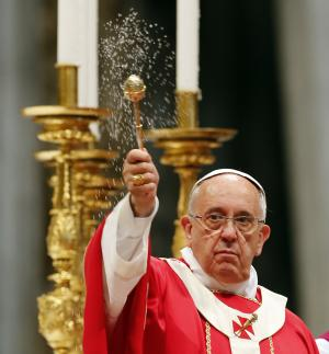 Pope Francis blesses the altar as he celebrates a mass …