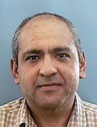 FILE - In this undated photo provided by the Anchorage Police Department, Rafael Mora-Lopez is shown. Mora-Lopez, a former Anchorage police officer convicted of living in the country illegally under a stolen identity for more than two decades, is scheduled to be sentenced Thursday, Aug. 25, 2011. Federal prosecutors are requesting a year in jail and a $250,000 fine for Rafael Mora-Lopez, who was born in Mexico and has lived in Alaska for years as Rafael Alberto Espinoza. (AP Photo/Anchorage Police Department, File)