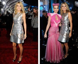 Katy Perry (L) and TV personality Heidi Klum backstage at the 2011 American Music Awards