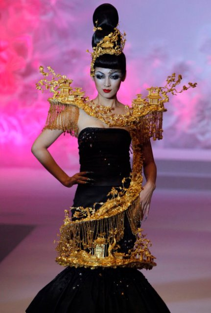 A model walks down the catwalk during the Mao Gepin make-up styling show at the China Fashion Week in Beijing, China, Tuesday, Nov. 1, 2011. (AP Photo/Ng Han Guan)
