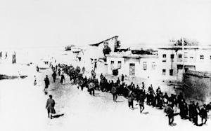 FILE - In this 1915 file photo, Armenians marched long…