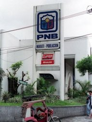 This file photo shows a Philippine National Bank (PNB) branch in Manila's financial district of Makati. Singapore's High Court has ruled that more than $23 million seized from the estate of late Philippine dictator Ferdinand Marcos rightfully belongs to the privately-owned PNB