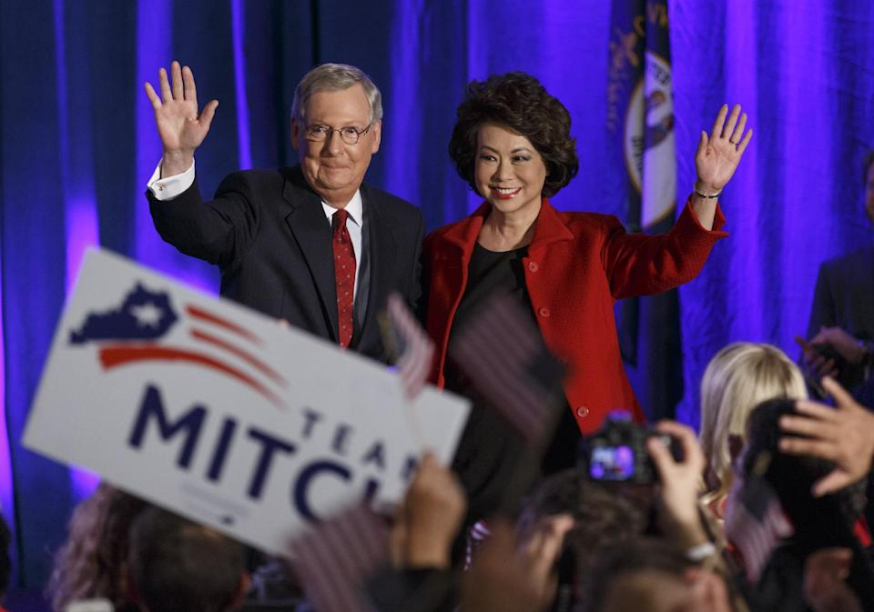 Senate Minority Leader Mitch McConnell of Ky.,  joined by his wife, former Labor Secretary Elaine Chao, celebrates with his supporters at an election ...