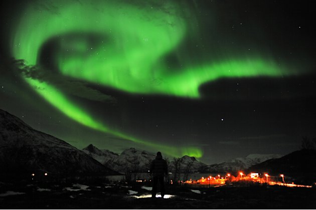 The aurora borealis, or Northern Lights, are seen near the city of Tromsoe, northern Norway, late Tuesday, Jan. 24, 2012. Stargazers were out in force in northern Europe on Tuesday, hoping to be awed