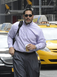 Former Tennessee Titans center and NFL Players Association President Kevin Mowae, enters a Manhattan law office, Friday, July 8, 2011, in New York. Members of the NFL Players' Association executive board and owners are meeting Friday in hopes of resolving a lockout that began in March. (AP Photo/ Louis Lanzano)