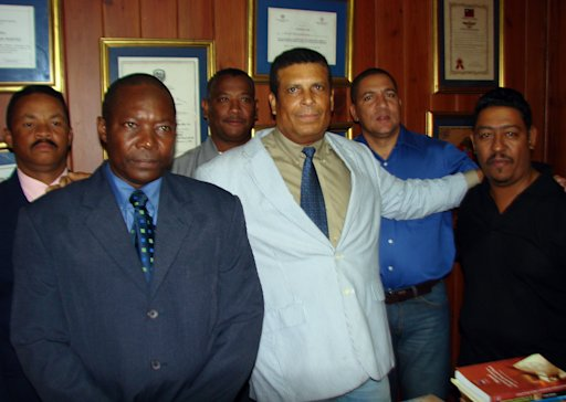 This picture taken in 2010 shows Dominican Republic's journalist Jose Agustin Silvestre, third from right, posing with unidentified members of the Dominican Human Rights Committee in La Romana, Dominican Republic. Silvestre promised to reveal a bombshell in the next edition of his magazine, a story of drugs and corruption involving local businessmen, but he was kidnapped and killed on Aug. 2, 2011 before he could publish his expose. (AP Photo/Alberto Calvo)