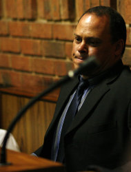 """Investigating officer Hilton Botha sits inside the witness box during the bail hearing for Oscar Pistorius at the magistrate court in Pretoria, South Africa, Thursday, Feb. 21, 2013. South Africa's National Prosecuting Authority acknowledged that the timing of attempted murder charges against a police detective leading the investigation into Oscar Pistorius is """"totally weird"""" and that he should dropped from the case against the world-famous athlete. (AP Photo/Themba Hadebe)"""
