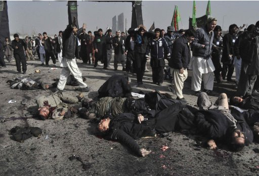 Dead bodies lay on the ground after a suicide blast targeting a Shi'ite Muslim gathering in Kabul