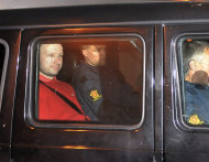 Norway's twin terror attacks suspect Anders Behring Breivik, left, sits in an armored police vehicle after leaving the courthouse following a hearing in Oslo, Norway, Monday, July 25, 2011, where he pleaded not guilty to one of the deadliest modern mass killings in peacetime. (AP Photo/Aftenposten/Jon-Are Berg-Jacobsen) NORWAY OUT