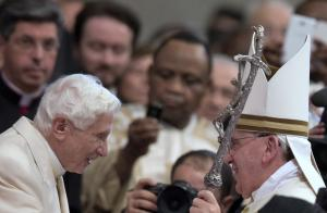 Pope Emeritus Benedict XVI is greeted by Pope Francis…