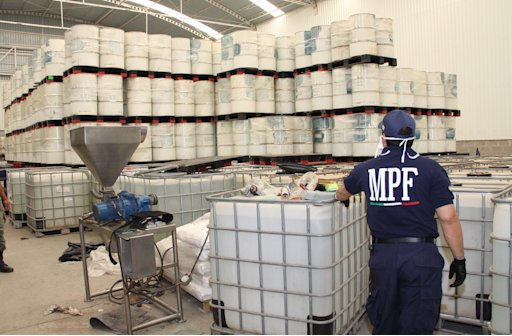 In this June 20, 2011, photo released by Mexico's Attorney General's office, police from the Federal Public Ministry looks at drums of precursor chemicals for methamphetamine that were seized in Queretaro, Mexico. Mexican authorities have made two major busts in as many months in the quiet central state of Queretaro. In one case, they seized nearly 500 tons (450 metric tons) of precursor chemicals. Another netted 3.4 tons (3.1 metric tons) of pure meth, which at $15,000 a pound would have a street value of more than $100 million. Mexico's most powerful drug cartel appears to be expanding methamphetamine production on a massive scale, filling a gap left by the breakdown of a rival gang that was once the top trafficker of the synthetic drug.  (AP Photo/Attorney General's office)