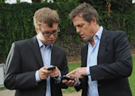 """British actor Hugh Grant, right, speaks with an unidentified 'Hacked Off' campaigner outside the Houses of Parliament in London, where a debate was being held into the allegations of phone hacking by journalists Wednesday July 6, 2011. Britain's voracious tabloids may have hit a new low: The News of the World, part of Rupert Murdoch's global media empire at News Corp, is facing claims that it hacked into a missing 13-year-old's phone messages, possibly hampering a police inquiry into her disappearance. """"Newspapers were using phone hacking on a widespread and industrial basis ... (with) the apparent collusion of parts of the Metropolitan Police,"""" actor Hugh Grant told BBC radio. (AP Photo/Stefan Rousseau/PA Wire) UNITED KINGDOM OUT"""